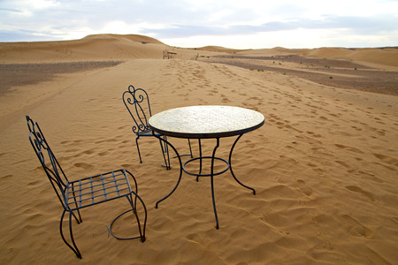 arid: table and seat in  desert sahara morocco    africa yellow sand