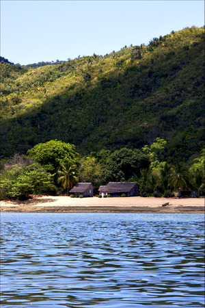 nosy: house hill navigable  froth cloudy  lagoon and coastline in madagascar nosy be Stock Photo