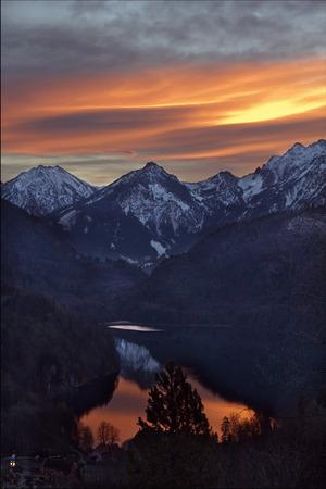neuschwanstein: sun snow mountain and lake in Neuschwanstein  germany Stock Photo