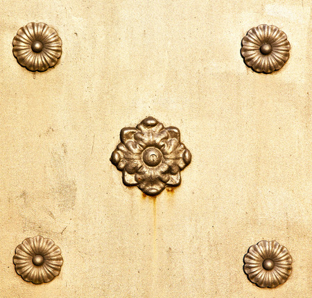 curch: in cislago   rusty brass brown knocker a  door curch  closed metal  italy  lombardy Stock Photo