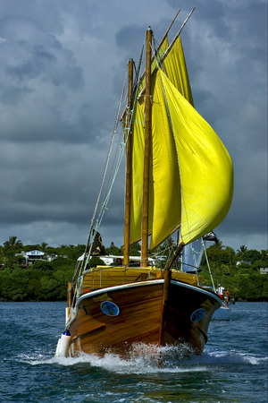 navigable: tropical lagoon hill navigable  froth cloudy  pirate boat  and coastline in mauritius