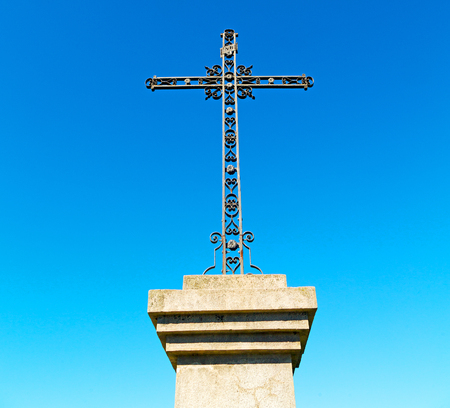 inri: abstract     cross in   italy europe and the sky background