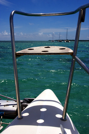 navigable: tropical lagoon hill navigable  froth cloudy  catamaran  boat  and coastline in Deer Island mauritius Stock Photo