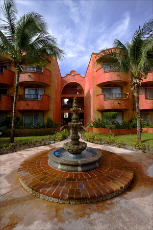 playa: mexico bush  fountain and red house  in playa del carmen Stock Photo