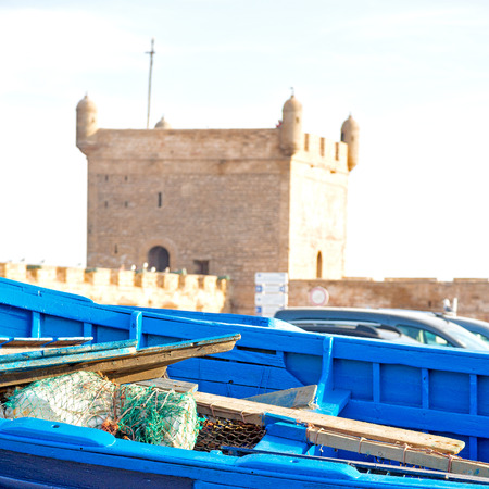 worl: boat and sea      in africa morocco old castle brown brick  sky pier