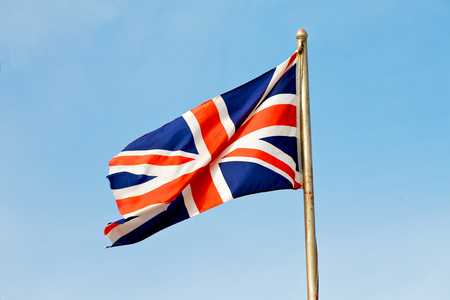 great britain flag: waving flag in the blue sky british colour and wave Stock Photo