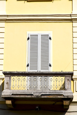 grate: yellow  europe  italy  lombardy        in  the milano old   window closed brick      abstract grate