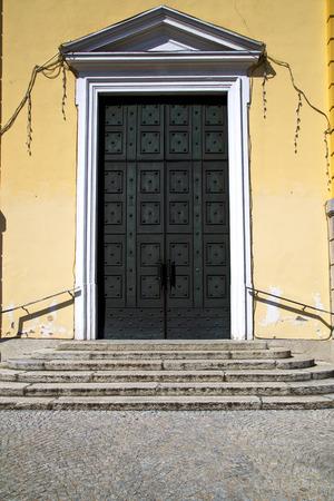 distort: brass brown knocker and wood  door in a church crenna gallarate varese italy
