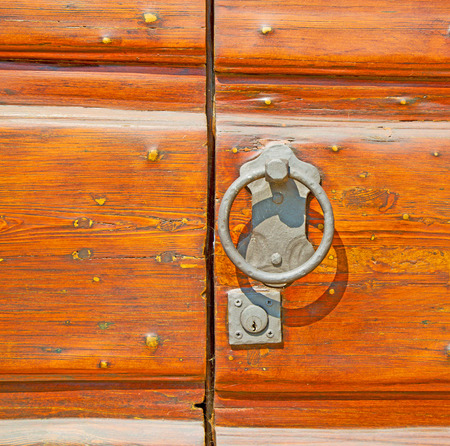 nail bar: europe old in  italy  antique close brown door and rusty lock  closeup