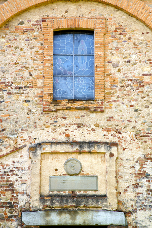 rose window: church  tradate varese italy the old rose window   and mosaic wall in the sky Stock Photo