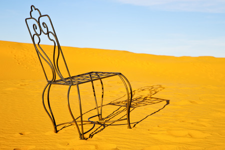 table and seat in  desert sahara morocco    africa yellow sand