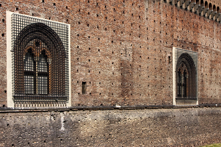 sforzesco: castle old brown  brick and window in the grass of castle sforzesco milan Editorial