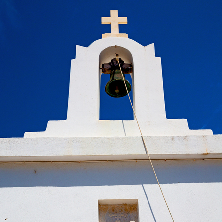 crucify: in europe    greece a cross bell    the cloudy sky