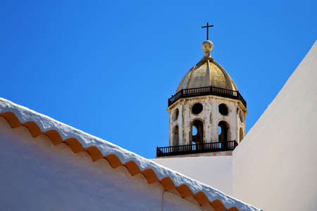 bell curve: the old terrace church bell tower in teguise arrecife lanzarote spain