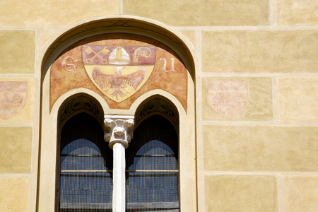 red cross red bird: tradate varese italy abstract  window monument curch mosaic in the yellow