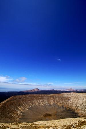 timanfaya: timanfaya vulcanic  rock stone sky  hill and summer in los volcanes lanzarote spain plant flower bush
