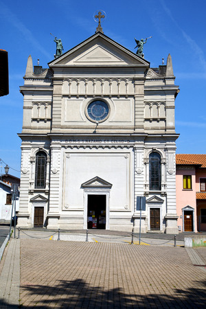 dorian: varese  castronno  in italy    the old wall  church and column blue sky Editorial