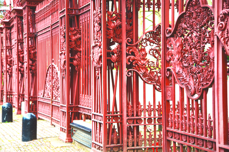 red    abstract metal in englan london railing steel and background