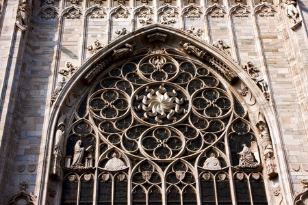 rose window: italy church  rose window  the front of the duomo  in milan and column Stock Photo