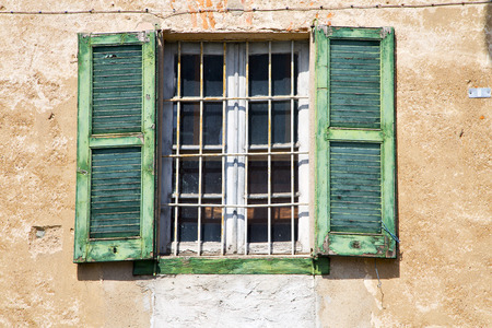 grudge: lonate ceppino varese italy abstract  window   green  wood venetian blind in the concrete Stock Photo