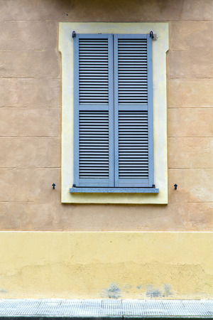 venetian blind: grey window   jerago    palaces italy   abstract  sunny day    wood venetian blind in the concrete  brick Stock Photo