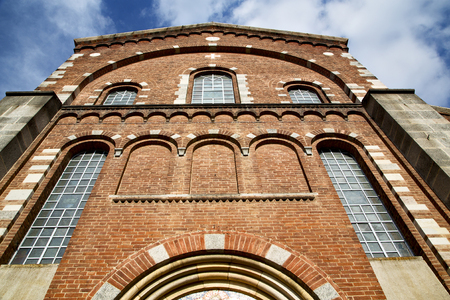 rose window: italy  lombardy     in  the   legnano  old   church   closed brick tower   wall rose   window tile Stock Photo
