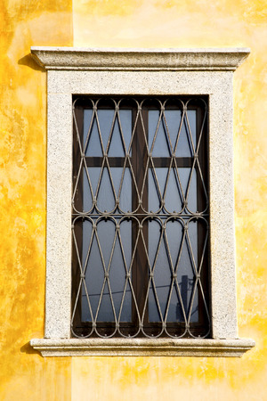 grate: shutter europe  italy  lombardy       in  the milano old   window closed brick      abstract grate