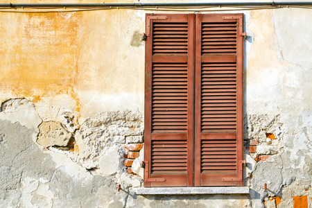 venetian blind: red window  varano borghi palaces italy   abstract  sunny day    wood venetian blind in the concrete  brick