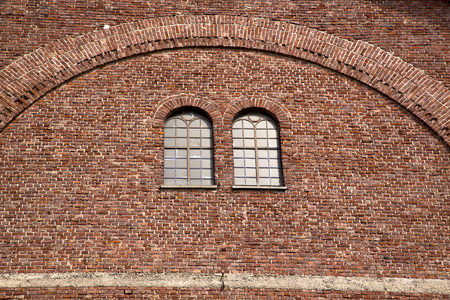 campo: italy  lombardy     in  the  cardano campo    old   church   closed brick tower   wall rose   window tile