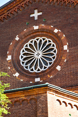 rose window: italy  lombardy     in  the castellanza   old   church   closed brick tower   wall rose   window tile Stock Photo