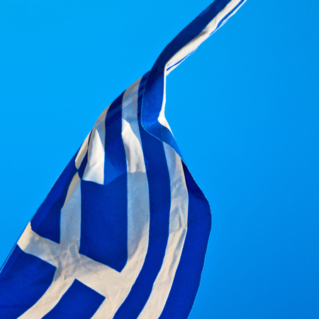 flagpole: waving greece flag  in the blue sky and      flagpole Stock Photo