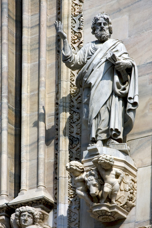 italy statue of a men in the front of the duomo  church in milan Stock Photo