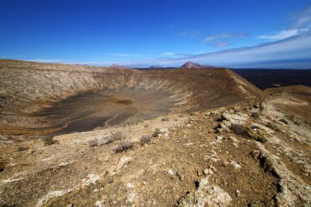 vulcanic timanfaya  rock stone sky  hill and summer in los volcanes lanzarote spain Stock Photo