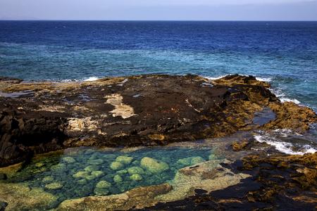 lagoon sky cloud beach  water  coastline and summer in lanzarote spain Stock Photo