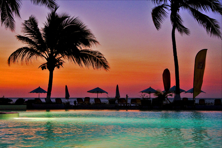 swimming pool sunset parasol  lagoon and coastline in madagascar nosy be Stock Photo