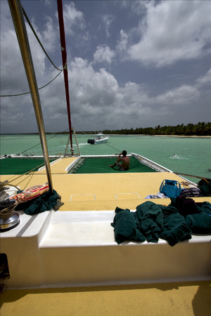 navigable: tropical lagoon catamaran navigable  froth cloudy   boat  and coastline in republica dominicana