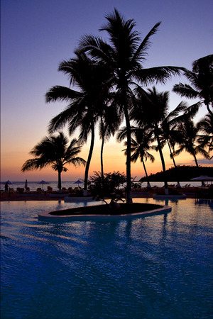 nosy: swimming pool sunset parasol  lagoon and coastline in madagascar nosy be Stock Photo