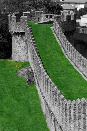 abstract castle brick and battlement in the grass of bellinzona switzerlan Stock Photo