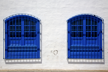 blue wood   couple of window in a white wall arrecife lanzarote spain