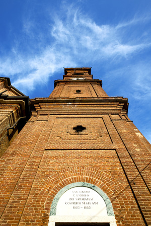 italy  lombardy     in  the samarate   old   church   closed brick tower   wall rose   window tile Stock Photo