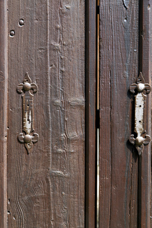 castellanza blur lombardy   abstract   rusty brass brown knocker in a  door curch  closed wood italy   cross