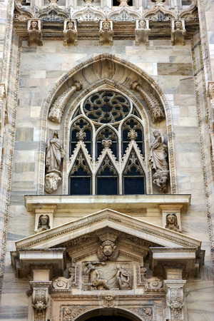 rose window: italy statues of a men in the front of the duomo  church in milan and rose window Stock Photo