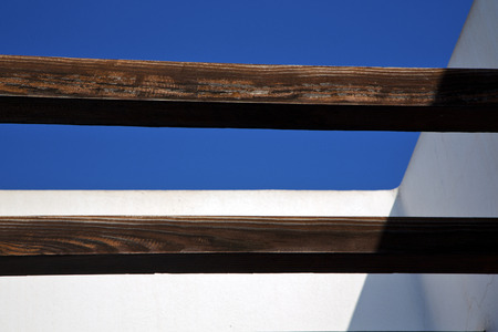 grudge: piece of brown   wood as a roof in the sky  lanzarote spain