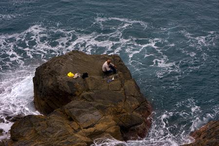 amore: fisherman abstract rock water   and coastline in via dell amore riomaggiore manarola italy