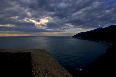 amore: clouds abstract rock water   and coastline in via dell amore  corniglia riomaggiore manarola italy Stock Photo