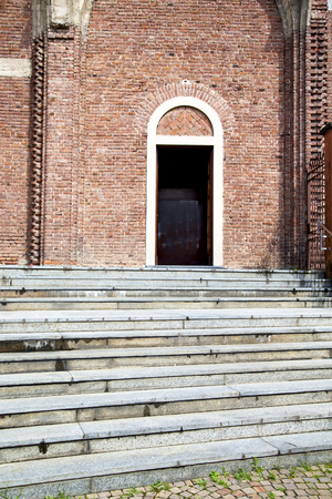campo: italy  lombardy     in  the cardano al campo old   church  closed brick tower     wall