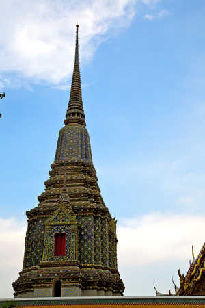 krung: bangkok in   temple  thailand abstract cross colors roof wat     asia sky   and  colors religion mosaic Stock Photo