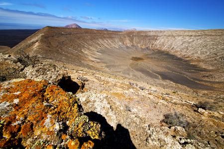timanfaya: vulcanic timanfaya  rock stone sky  hill and summer in los volcanes lanzarote spain Stock Photo