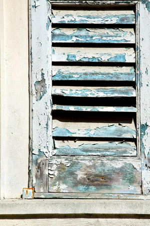 venetian blind: venegono varese italy abstract  window      wood venetian blind in the concrete  brown Stock Photo