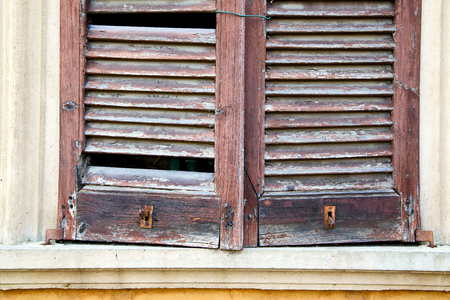 iron curtains: italy abstract  window mornago varese    wood venetian blind in the concrete  grey Stock Photo